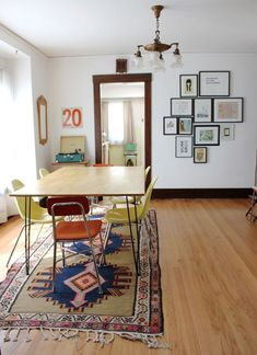 a pretty space to be.  love the artwork cluster. http://smileandwave.typepad.com/blog/2012/05/our-colorado-home-dining-room.html
