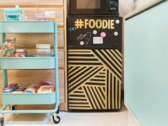 Mini refrigerators are useful, but they aren't all that attractive. Personalize your dorm room refrigerator using strips of washi tape. We created an abstract stripe design with metallic gold tape.