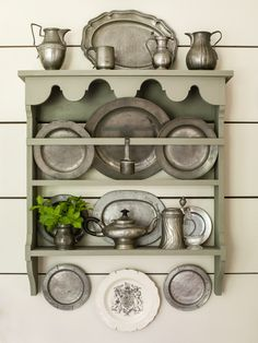 pewter collection displayed on a wall mounted shelving unit   home decor + decorating ideas
