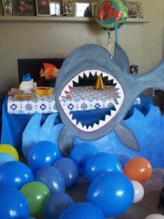 Fun Photo Booth idea %u2013 take pics with kids heads in shark%u2019s mouth. Hang a blue tablecloth as a backdrop%u2026.great for kids nautical, under the sea, Nemo or shark party! Send to guests later with thank you cards.