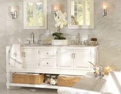 Love these sconces and the mirrors. Pottery Barn's Sussex Tube sconce and sonoma recessed medicine cabs.