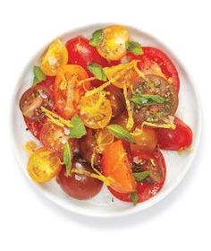 Tomato Salad With Ginger and Mint - 3 pounds tomatoes, cut up 2 tablespoons canola oil 1 tablespoon finely grated fresh ginger kosher salt and black pepper 2/3 cup torn fresh mint leaves 1 tablespoon finely grated lemon zest