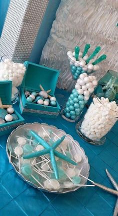 Themed candy at a dolphin baby shower party! See more party planning ideas at CatchMyParty.com!