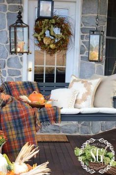 Throw a plaid blanket over your porch furniture to make everything feel cozy. Door tags and pumpkin decor