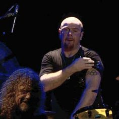 Jason Bonham (with Plant in front)