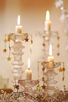 White candles in crystal candle holders with gold stars. I like this change away from the white and silver. Would think it would look great with dark blue candles and gold stars! Merry Christmas, Christmas Candles, White Christmas, Christmas Time, Christmas Crafts, Xmas, Christmas Stars, Modern Christmas, Scandinavian Christmas