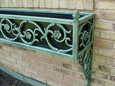 Window Box 2.1 – A detail of a window box using cast iron designs.