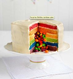 Skittles rainbow birthday party cake - SURPRISE! http://www.sainsburysmagazine.co.uk/recipes/baking/special-occasion-cakes/item/surprise-skittles-rainbow-cake