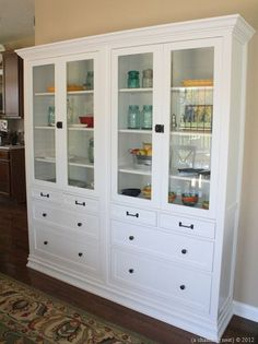 Materials: Hemnes Glass Door Cabinet with 4 Drawers (2) Description: We used two Hemnes cabinets to make a custom built in china cabinet in our kitchen.   See more of the Hemnes built-in and this post