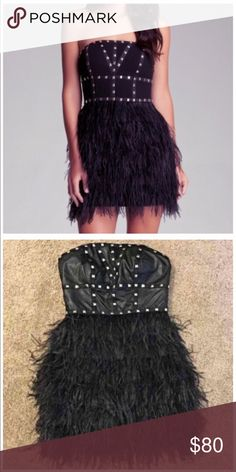 Small faux leather feathered Studded dress This sexy dress was worn only once... so much life left in this bad boy!! bebe Dresses Mini