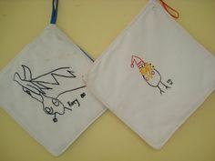 Embroider children's art on a pot holder or dish towel.