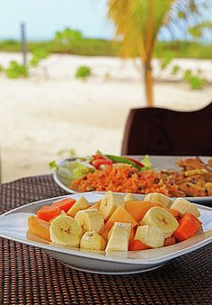 Fruit salad and chicken rice served on beach by Nadya&Eugene Photography #Food #Banana #MexicanCuisine