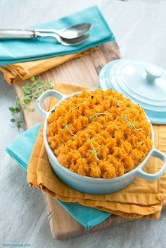 This Sweet Potato Chicken Cottage Pie is a super easy healthy take on one of the most popular British comfort foods - Ready in 30 min, gluten-free and packed with extra veggies! Recipe by The Petite Cook - www.thepetitecook.com