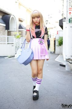 whatjapanswearing:  tokyo-fashion:  17-year-old Rinalee on the street in Harajuku w/ lace-sleeve Katie top, lace suspenders, Milk heart bag,...