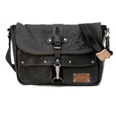 This original upcycled/recycled messenger bag, is made from a recycled black leather-jacket, which is in a distressed look. Inside there are two