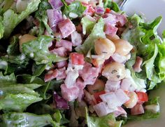 I really like Pagliacci's Pagliaccio Salad, so I found the recipe to it. Green leaf lettuce tossed with garbanzo beans, diced red peppers, kasseri cheese, salami, red onions and our Dijon vinaigrette.