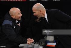 Real Madrid manager Zinedine Zidane greets Sevilla FC manager Jorge Sampaoli during the Copa del Rey Round of 16 First Leg match between Real Madrid and Sevilla at Bernabeu on January 4, 2017 in Madrid, Spain.
