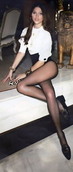 Very nice long legs in black hosiery !!