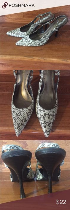 """BCBGirls Pumps BCBGirls Brown & Taupe Gold Fabric Heel  Great Pre-owned Condition. Brown lettering with a dark beige to taupe background. Brown faux patent leather 3.5"""" heels.   Size 8 Medium/B Insole Length:  9 3/4"""" Insole Width:  3"""" BCBGirls Shoes Heels"""
