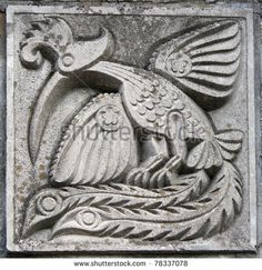 old bas-relief of fairytale fantasy firebird on the wall