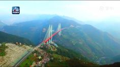 The world's highest bridge, the 1341m-long Beipanjiang Bridge was put into operation on Dec. 29. The bridge stands 565m above a river and cut road trips from Liupanshui in Guizhou to Xuanwei in Yunnan from four to two hours. (Video: CCTV) #VideofromChina