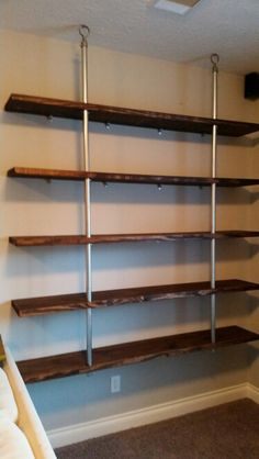 Industrial shelves from fence post.