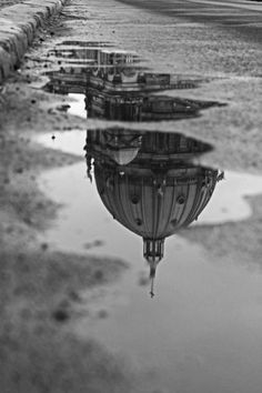Reflection in water of a domed building