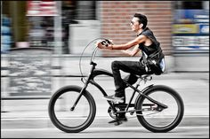 https://flic.kr/p/p14Dsg | Black Bicycle Man | I have photographed this fellow riding his black bicycle on Bank Street 4 times over 3 years.