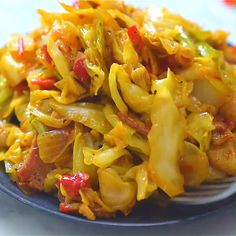 This Fried Cabbage recipe is insanely good! Made with bacon, onion, bell pepper, and a touch of hot sauce, it is easy to Fried Cabbage Recipes, Bacon Fried Cabbage, Onion Recipes, Vegetable Recipes, Vegetarian Recipes, Chicken Recipes, Cooking Recipes, Healthy Recipes, Baby Cabbage Recipe