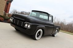 1957 Ford F100 Rat Rod Hot Rod. Nice and clean, flat black with white walls and white trim. Shaved smooth.
