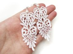 DIY Lace Earrings~ These lovely earrings add femininity and charm to your outfit! The desired lace pattern was cut from lace trim. Show off how stunning they are with your hair pulled up in a bun or pony tail.