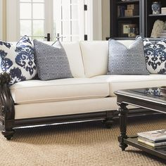 Showcasing elegant hand-carved details and brass nailhead trim, this classic sofa adds a cozy touch to your home library or living room seating group.