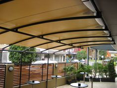 Waterproof Shade Structure from Eclipse Shade & Sales in Australia.  I hope these come to the US SOON!  I want one over my front courtyard and around 1/2 my house in back.  NEED is more like it!