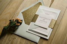 Gold glitter wedding invitation suite from Jupiter and Juno. Swoon!