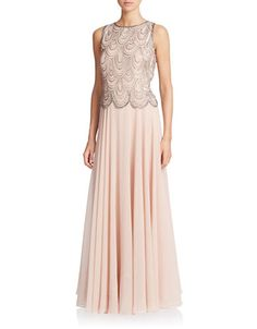 This stunning blush-hued gown flaunts a glittering sequined and beaded popover with scalloped hem and a sweeping skirt.