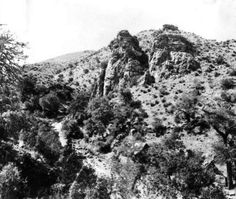 An early 1880s view of Castle Rock in Bisbee.  Note the cabin at the base of the limestone mass.  The cabin was the home of Bisbee's infamous prospector George Warren.  This image is from the photograph collection of the Bisbee Mining & Historical Museum.  Discover more Bisbee, Arizona images and artifacts at www.facebook.com/BisbeeMuseum. #bisbee #arizona #bisbeemuseum #history #limestone