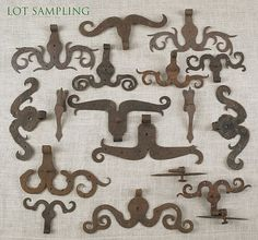 """Collection of wrought iron ram's horn hinges, early 19th c., to include six pairs, six singles, and two pair of door pintles, largest - 15"""" l."""