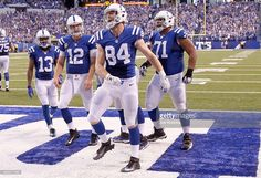 Jack Doyle #84 of the Indianapolis Colts celebrates with teammates after scoring a touchdown in the fourth quarter of the game against the Detroit Lions at Lucas Oil Stadium on September 11, 2016 in Indianapolis, Indiana.