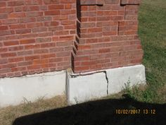 Cracks at foundation-cladding interfaces point to insufficient provisions for material movement. Masonry Construction, Brick Masonry, Cladding, Foundation, Building, Outdoor Decor, Brickwork, Buildings, Foundation Series