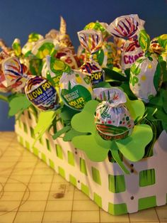 "clover lollipop ""garden"" for St Patty but I would change this into 100 day project with different colored flowers! That's a lotta lolli's!!!"
