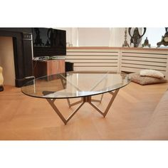 glazentafel.com | glazen salontafel Piacenza | Deze hardglazen ovale salontafel is gemaakt van helder glas met een sierlijke frame in geborsteld roestvrij staal (RVS). De Modena salontafel is ook verkrijgbaar in een ronde of rechthoekige vorm.
