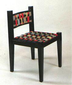 Chair by Marcel Breuer with interlacing woolen straps  woven by Gunta Stoelzl  Bauhaus Weimar, 1921