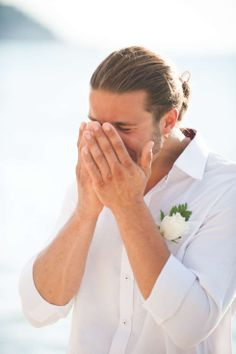 A Beutiful shot capturing the grooms face when he first sees the bride...a perfect moment. By Khun Aez