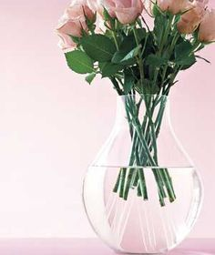 DIY BOUQUET :: Plastic Straw as Stem Extender :: Boost a meager bouquet to new heights by inserting short flower stems into plastic straws to give them greater stature. | #bouquet #realsimple #straws