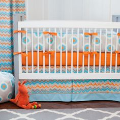 Gray and Orange Ikat Dot Crib Bedding | Carousel Designs.  Bright and bubbly, this fun and light-hearted Ikat dot features bold shades of aqua and orange. Its whimsical feel is sure to set your nursery apart from the ordinary.
