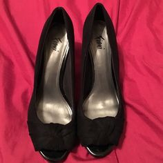 Fioni Black Heels in 8W For sale I have a pair of Fioni black heels with an open toe and knot design. These were worn once and as shown in the pictures they still look excellent. Fioni Shoes Heels
