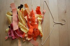 Diy Fall Wreaths  Materials:   Scraps of fabric (fall color themes)  Wire hanger  Ribbon to hang wreath