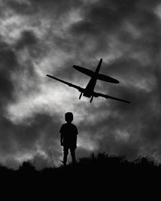 Amazing Black & White Photography | Creative Greed A young boy dreams of what he will become.
