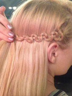 Learned this on YouTube! Take a section of hair (just as youd do a regular braid) and braid it like normal til the end, then, take the outer two strands, and hold the middle strand tight. Next, slide the two strands youve brought together, up. This will create this awesome look!