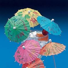 """Cocktail Parasols by FUN EXPRESS. $13.44. Paper cocktail umbrellas 4"""" long toothpick with 4"""" diameter opened umbrella Package includes assorte. Whether you are having a beach party, a pool party, or a tropical luau you have come to the right place. Cocktail parasols are a great way to turn any drink into a luau drink. These mini drink umbrellas are a classic drink item for a luau party. The cocktail parasols are easily recognizable and a great way to spice up any luau drink..."""